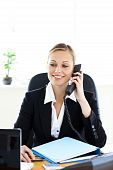 Self-assured Businesswoman Talking On Phone In Her Office