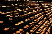 Candles In Several Rows In The Church