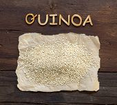 picture of quinoa  - Quinoa and a word Quinoa on a wooden table - JPG