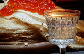 Wine-glass Of Vodka And Pancakes With Red Caviar