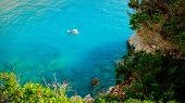 Small Yacht Anchored At Porto Katsiki Beach On Lefkada Island, Greece
