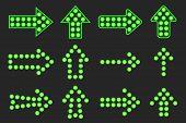 Set of arrows of green light.