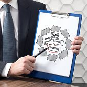 businessman in office holding clipboard