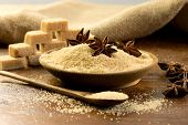image of sugar cube  - brown sugar and sugar cubes on a rustic table - JPG