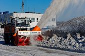 NIZHNY NOVGOROD. RUSSIA. FEBRUARY 17, 2015. The rotor ZAUGG snowplow in operating time