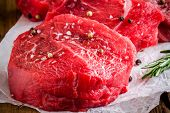 Raw Steaks With Rosemary, Sea Salt And Pepper