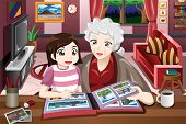picture of grandma  - A vector illustration of grandma and granddaughter looking at picture album - JPG