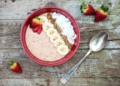 stock photo of porridge  - Trendy porridge decorated with fruits and coconut chips - JPG