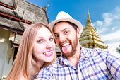 Beautiful Couple taking a selfie photo in Thailand
