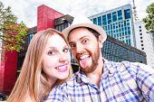 Beautiful Couple taking a selfie photo in Sao Paulo, Brazil
