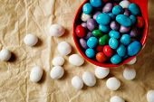 Colorful Candies Like Sea Pebbles On Craft Paper