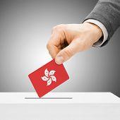 Voting Concept - Male Inserting Flag Into Ballot Box - Hong Kong