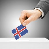 Voting Concept - Male Inserting Flag Into Ballot Box - Iceland