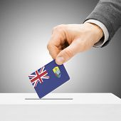 Voting Concept - Male Inserting Flag Into Ballot Box - Saint Helena