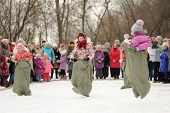Little Girls Sack-racing During Winter Maslenitsa Carnival In Russia