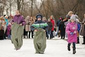 Children Sack-racing During Winter Maslenitsa Carnival In Russia