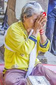 SIEM REAP, THAILAND, DECEMBER 28, 2013: Female buddhist believer prays in ruins of Angkor