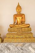 BANGKOK, THAILAND, DECEMBER 26, 2013: Statue in Wat Pho temple