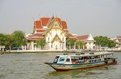 BANGKOK, THAILAND, DECEMBER 26, 2013: Tourists travel by boat on Chao Phraya River