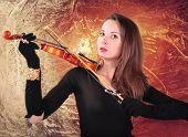 beautiful girl in black plays  the violin