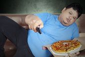 Man Eats Pizza While Watching Tv 1