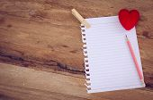 Note Book Paper With Pencil And Heart On   Wooden Background