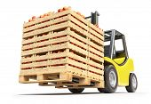 Forklift with red apples in wooden crates