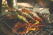 pic of flame-grilled  - Grilled thai river prawns with butter and herb on flaming grill - JPG