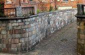 Small Alley Between A Brick Wall