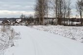 stock photo of snowy-road  - country snowy road in winter rural area - JPG