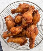foto of southern fried chicken  - Homemade fried chicken drumsticks cooking with original thai style - JPG