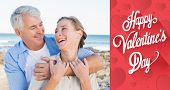 Happy casual couple by the coast against cute valentines message
