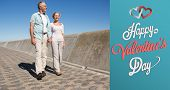 Happy senior couple walking on the pier against cute valentines message