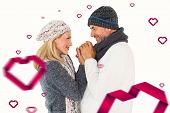 Couple in winter fashion embracing against hearts
