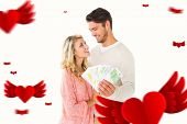 Attractive couple flashing their cash against hearts