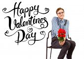 Geeky hipster holding a bunch of roses against happy valentines day