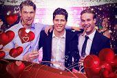 Handsome friends having a drink together against valentines heart design