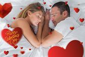 Cute couple lying asleep in bed against happy valentines day