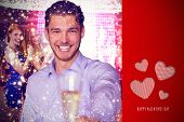 Man offering champagne against cute valentines message