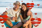 Smiling couple embracing while having a drink together against cute valentines message