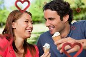 Two friends laughing while holding ice cream against hearts