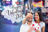 Woman surprising boyfriend with gift against blurry new york street