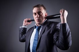 picture of bat  - adult male gangster in a business suit with a baseball bat - JPG