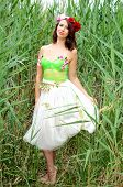 picture of barefoot  - Barefoot woman surrounded by reeds - JPG