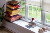 picture of guest-house  - Books Coffee and Cookies with Piled Square Pillows at the Reading Corner Inside the House for Reading Time Concept - JPG