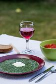 pic of marsala  - spinach in marsala color plate with tomatoes brown bread and wine - JPG
