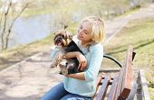 image of yorkshire terrier  - Happy young girl owner with yorkshire terrier dog walking in the park - JPG