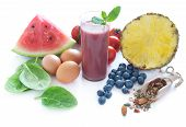 foto of cellulite  - Anti cellulite foods including tomatoes spinach blueberry smoothie watermelon seed mix and eggs over a white background - JPG