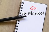 stock photo of going out business sale  - White notepad and ink pen on the wooden desk Go to market concept - JPG