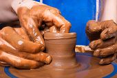 image of train-wheel  - Potter trains to work on pottery wheel - JPG